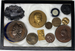 Coin collection including Ulysses S. Grant, Queen Victoria, the Wright brothers, French Republic coin and others