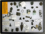 Roman accessories including weights, belt fittings, seals brooches, buckles and a mirror