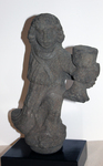 Stone sculpture of a cup bearing deity