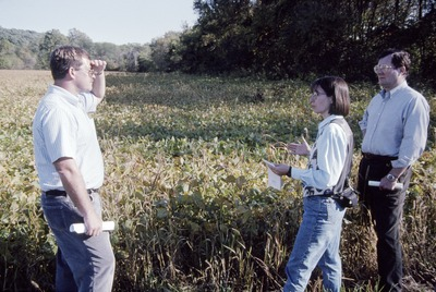 Mike Daley and weed walk by soybean field