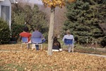 Students observing Bird Feeding From Chairs-Biology 262