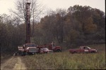 KCES Pond project: well drilling at prarie edge, rig and trucks