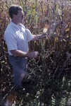Mike Daley inspecting corn KCES walk