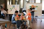 Children and Kenyon student performing their original skit