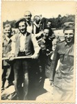 German soldiers and civilians smiling at camera (Holocaust in Ukraine)