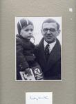 Signed Photograph of Nickolas Winton, savior of 669 Jewish children in the Czechoslovakian Kindertransport, Holding a Child