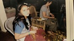 Eleven-year-old Betania sits next to Tia Graciela shucking Beans (2011) by Betania Escobar