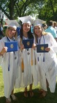 Scout at her high school graduation with two close friends (2016) by Scout Crowell