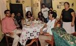 The Escobar family sits for dinner from left to right Papa Jose, Tia Graciela, Tio Juan, la esposa del Tio Juan, Tia Dinora, Eliseo, Sarai, Moises, Jorge, Tia Maria, Tio Toño (2011) by Betania Escobar