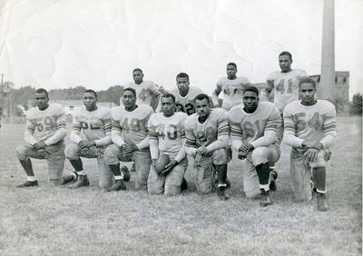 Gene Rouse (center holding football, wearing No. 40 jersey) and his Central State University football team, circa 1950