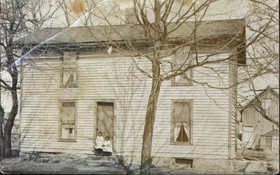 House and Two Young Children ca. 1900