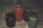 It is a line-up of Kate Brown's canned goods, from tomato paste to beans.