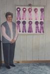 Ethel Garver standing beside her quilt