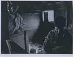 Two Young Boys Play in Barn