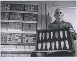 A Man Holds a Group of Arrowheads