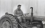 A Farmer on a Tractor