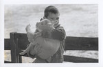 A Boy Holding a Lamb