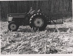 A Farmer Drives a Tractor