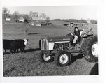 Student on a Tractor with the Hall's