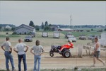 Tractor pull contestants and observers by Eleanor S. Dahlin