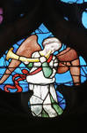 Sens Cathedral, North transept rose window, angel plays horn, 1516, Flamboyant Gothic, stained glass, France.