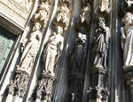 Cologne (Koln) Cathedral of St. Peter and St. Mary, detail of jamb figures of saints with sculpted canopies and socles, High Gothic, Cologne, Germany