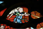 Sens Cathedral, North transept rose window, angel blowing horn, 1516, Flamboyant Gothic, stained glass, France.