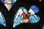 Sens Cathedral, St. Stephen's Cathedral, Angelic Musician Blows Horn and Plays Drum, detail of north transept rose window, Flamboyant Gothic stained glass, early 16th century, France.