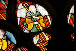 Sens Cathedral, North transept rose window, angel blows horn, 1516, Flamboyant Gothic, stained glass, France.