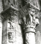 Ripoll, Monastery of Santa Maria, portal sculpture, atlantid, beast's head, zodiac roundels and Corinthian capital decoration on jamb columns, Romanesque sculpture, Spain