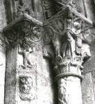 Ripoll, Monastery of Santa Maria, portal sculpture, atlantid, beast's head, zodiac roundels and Corinthian capital decoration on jamb columns, Romanesque sculpture, Spain