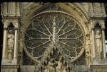 Reims Cathedral, detail of rose window above central tympanum with gable sculpture of the Coronation of the Virgin, 13th century