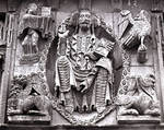 Moarves de Ojeda, Church of San Juan, Christ Pantocrater with symbols of the Four Evangelists, center, frieze above the portal, Romanesque, early 12th century. Palencia, Spain