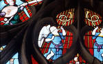 Sens Cathedral, St. Stephen's Cathedral, Angelic Musician Plays Horns, detail of north transept rose window, Flamboyant Gothic stained glass, early 16th century, France.