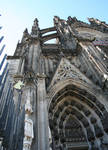 Cologne (Koln) Cathedral of St. Peter and St. Mary, detail of portal and flying buttress, High Gothic, Cologne, Germany
