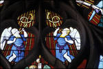Sens Cathedral, North transept rose window, two angels blow horns, 1516, Flamboyant Gothic, stained glass, France.