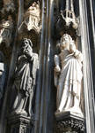 Cologne (Koln) Cathedral of St. Peter and St. Mary, detail of jamb figures of saints with sculpted canopies, High Gothic, Cologne, Germany