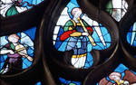 Sens Cathedral, St. Stephen's Cathedral, Angelic Musician Plays Recorder, detail of north transept rose window, Flamboyant Gothic stained glass, France.