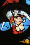 Sens Cathedral, St. Stephen's Cathedral, Angelic Musician Plays Musical Instrument, detail of north transept rose window, Flamboyant Gothic stained glass, early 16th century, France.