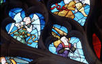 Sens Cathedral, St. Stephen's Cathedral, Angelic Musician Playing the Flute and the Triangle, detail of north transept rose window, Flamboyant Gothic stained glass, early 16th century, France.