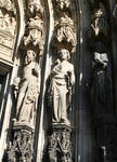 Cologne (Koln) Cathedral of St. Peter and St. Mary, detail of jamb figures of saints with sculpted canopies, lower archivolts, High Gothic, Cologne, Germany