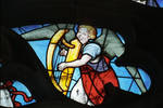 Sens Cathedral, North transept rose window, angel plays a harp, 1516, Flamboyant Gothic, stained glass, France.