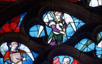 Sens Cathedral, St. Stephen's Cathedral, Angelic Musician Plays Bagpipes, detail of north transept rose window, Flamboyant Gothic stained glass, early 16th century, France.