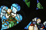 Sens Cathedral, North transept rose window, angel plays flute (l) and drums (r), 1516, Flamboyant Gothic, stained glass, France.