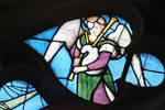 Sens Cathedral, North transept rose window, angel plays bagpipes, 1516, Flamboyant Gothic, stained glass, France.
