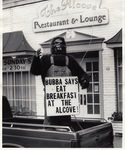 Person in Gorilla Suit with Sign Outside the Alcove
