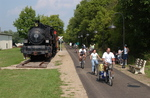 Bikers pass an old Locomotive on the Kokosing Gap Trail