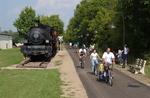 Bikers pass an old Locomotive on the Kokosing Gap Trail