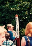 "Children look at ""May Peace Prevail on Earth"" Sign"