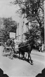 "Man in horse carriage holds ""Timeless Victory"" in front of the Church"